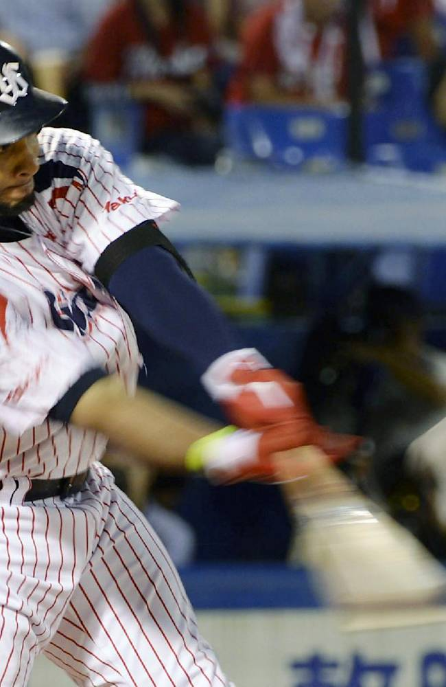 Yakult Swallows' Wladimir Balentien hits his 55th home run of the season off Hiroshima Carp's Kan Otake in the sixth inning of their regular season game at Jingu Stadium in Tokyo Wednesday, Sept. 11, 2013. Former major leaguer Balentien matched Japan record set by Sadaharu Oh in 1964 and equaled by ex-major leaguers Tuffy Rhodes in 2001 and Alex Cabrera in 2002