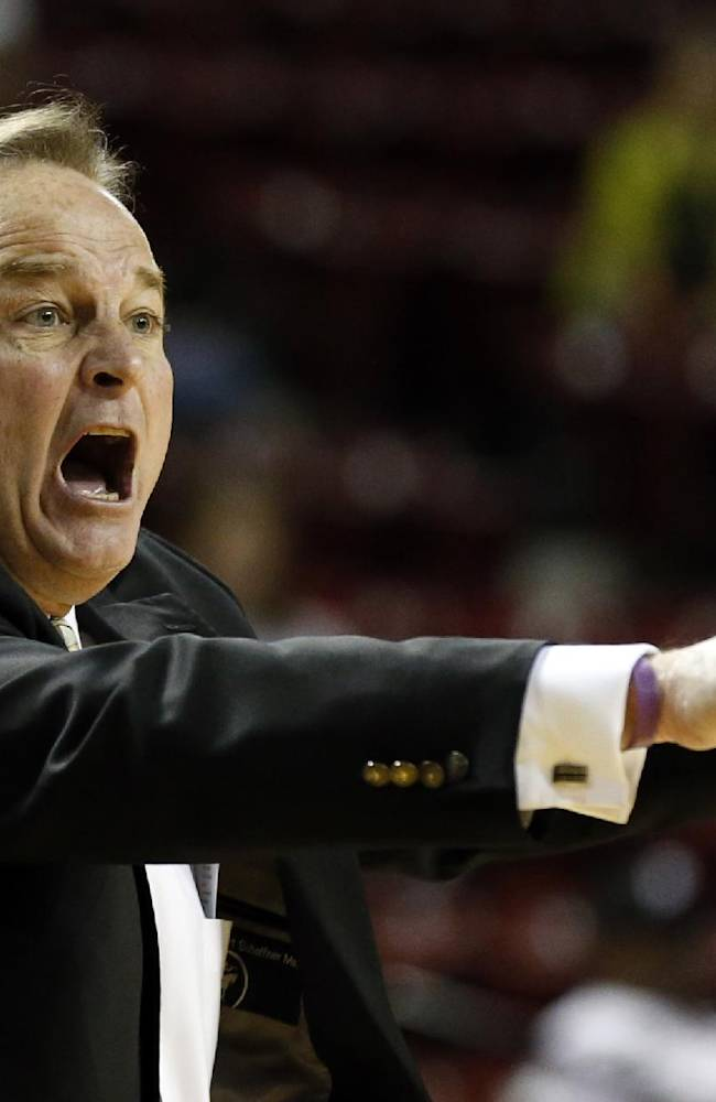 Mississippi State basketball coach Vic Schaefer calls out to his players in the first half of an NCAA college basketball game against South Carolina in Starkville, Miss., Thursday, Feb. 6, 2014