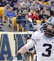 North Carolina's Ryan Switzer (3) is greeted by Desmond Lawrence (2) and other teammates after returning a punt 65-yards for a touchdown in the second quarter of an NCAA football game against Pittsburgh on Saturday, Nov. 16, 2013 in Pittsburgh. (AP Photo/Keith Srakocic)