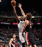 CHARLOTTE, NC - MARCH 22: Al Jefferson #25 of the Charlotte Bobcats shoots against Robin Lopez #42 of the Portland Trail Blazers at the Time Warner Cable Arena on March 22, 2014 in Charlotte, North Carolina. (Photo by Brock Williams-Smith/NBAE via Getty Images)