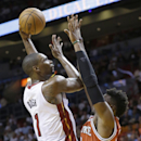 Miami Heat center Chris Bosh (1) shoots against Milwaukee Bucks forward Jeff Adrien during the first half of an NBA basketball game on Wednesday, April 2, 2014, in Miami The Associated Press