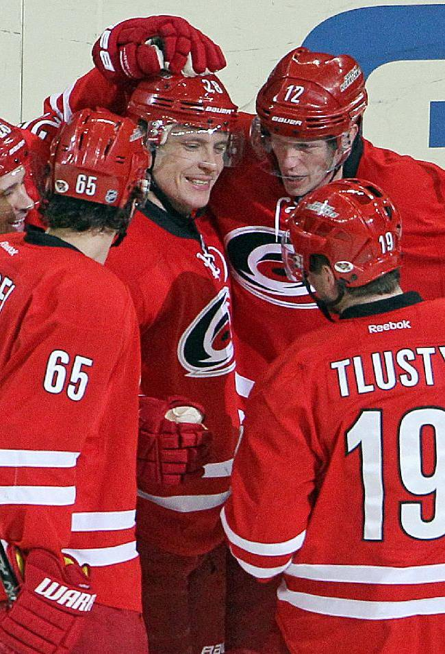 Carolina Hurricanes' Alexander Semin (28) of Russia, is congratulated on his goal by teammates Eric Staal (12), John-Michael Liles (26), Ron Hainsey (65) and Carolina Hurricanes' Jiri Tlusty (19) of Czech Republic, during the third period of an NHL hockey game against the Florida Panthers in Raleigh, N.C., Saturday, Jan. 18, 2014. Hurricanes won 3-2