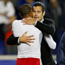 New York Red Bulls head coach Mike Petke, right, hugs forward Thierry Henry (14) after defeating Sporting Kansas City 2-1 in an MLS playoff soccer match at Red Bull Arena in Harrison, N.J., Thursday, Oct. 30, 2014 The Associated Press