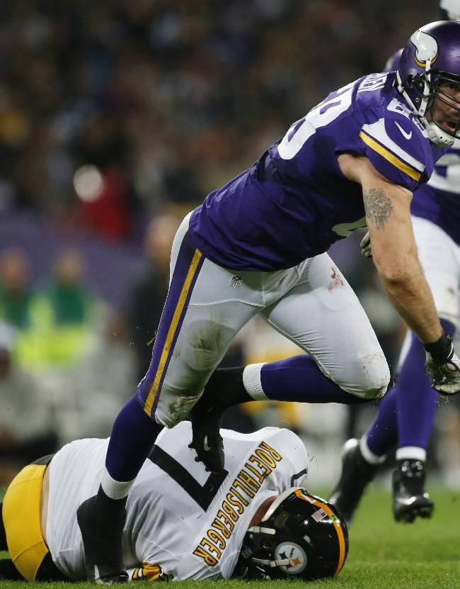 Minnesota Vikings defensive end Jared Allen leaves Pittsburgh Steelers quarterback Ben Roethlisberger on the ground after sacking him during the first half of their NFL football game at Wembley Stadium, London, Sunday,Sept. 29, 2013
