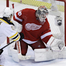 Detroit Red Wings goalie Jonas Gustavsson (50) deflects a shot by Boston Bruins left wing Justin Florek (57) during the third period of Game 4 of a first-round NHL hockey playoff series in Detroit, Thursday, April 24, 2014 The Associated Press