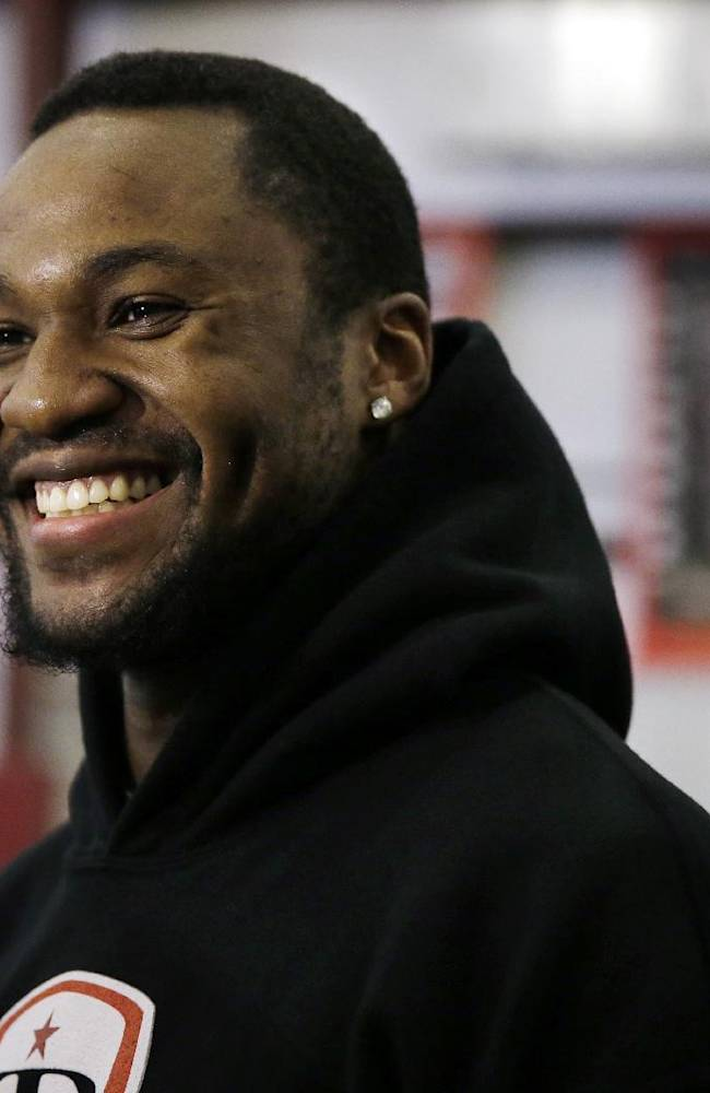 In this Feb. 14, 2014 photo, LSU wide receiver Kadron Boone smiles as he answers a question between training sessions at TEST Sports Clubs in Martinsville, N.J. College players from across the country come here to prepare for the NFL scouting combine in Indianapolis, the regional combines and their pro days.