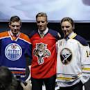 From left, Edmonton Oilers' Leon Draisaitl, Florida Panthers' Aaron Ekblad and Buffalo Sabres' Sam Reinhart pose for photographs during the first round of the NHL hockey draft, Friday, June 27, 2014, in Philadelphia. (AP Photo/Matt Slocum)