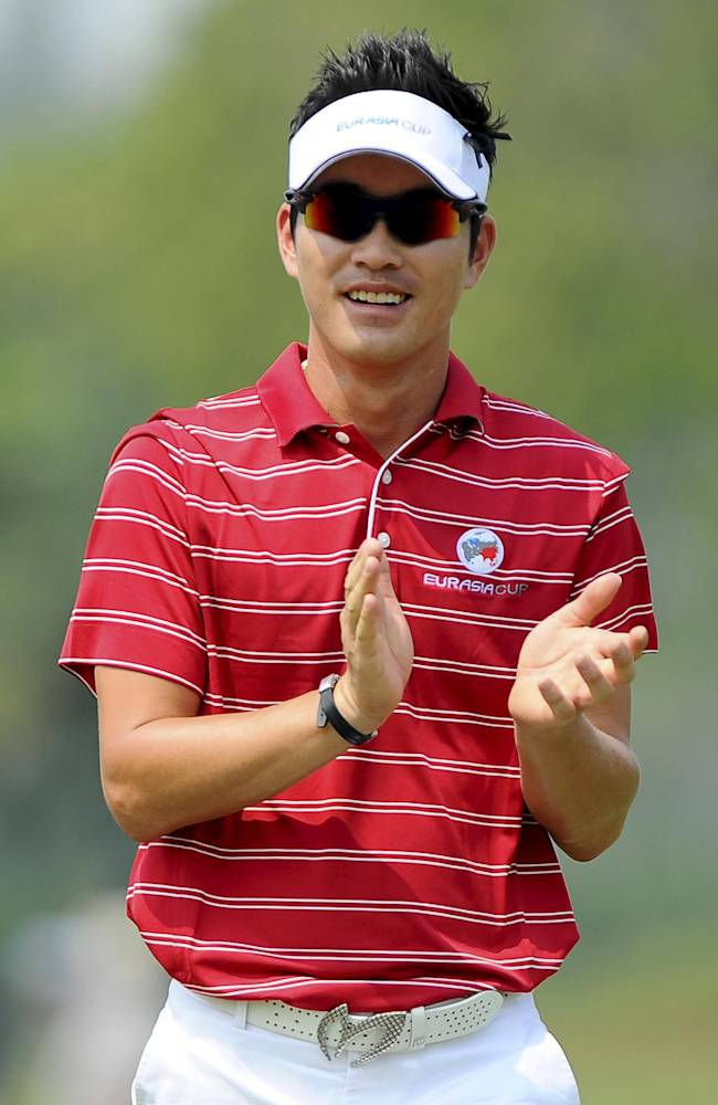 South Korea's Kim Hyung-sung claps hands on the eighth hole during the second round of the EurAsia Cup golf tournament at the Glenmarie Golf and Country Club in Subang, Friday, March 29, 2014