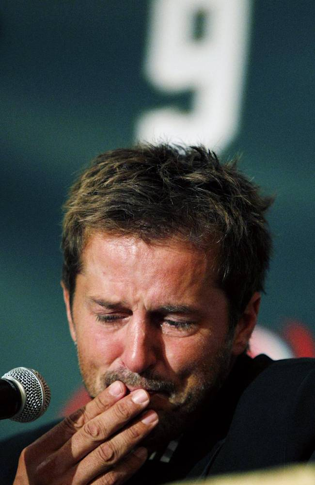 In this Sept. 23, 2011 file photo NHL hockey player Mike Modano gets choked up during a news conference announcing his retirement in Dallas. Modano had several tearful farewells as his playing days wound down. The guy who made hockey cool in Dallas figures he'll get emotional again for the final ceremony: retiring his iconic No. 9 during the  Dallas Stars' game against Minnesota on Saturday, March 8