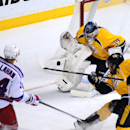 Nashville Predators goalie Marek Mazanec (39), of the Czech Republic, stops the shot of New York Rangers right wing Ryan Callahan (24) who shoots past Predators forward Mike Fisher (12) in the first period of an NHL hockey game on Saturday, Nov. 23, 2013,