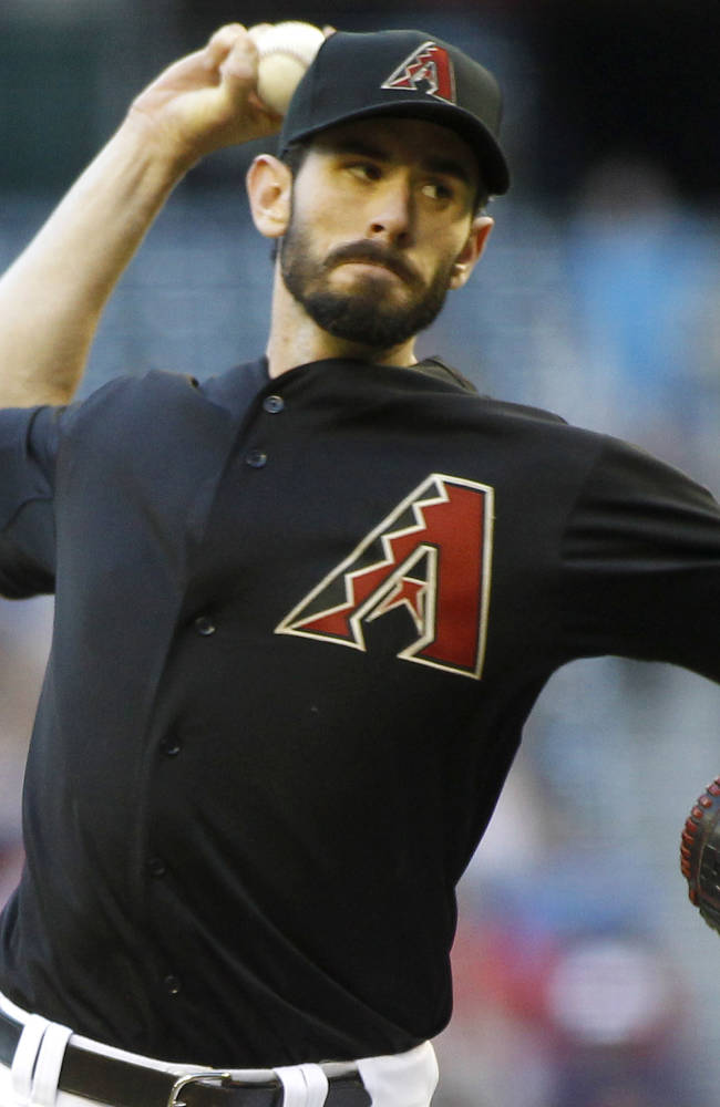 Arizona Diamondbacks pitcher Brandon McCarthy delivers against the Washington Nationals during the first inning of a baseball game on Saturday, Sept. 28, 2013, in Phoenix