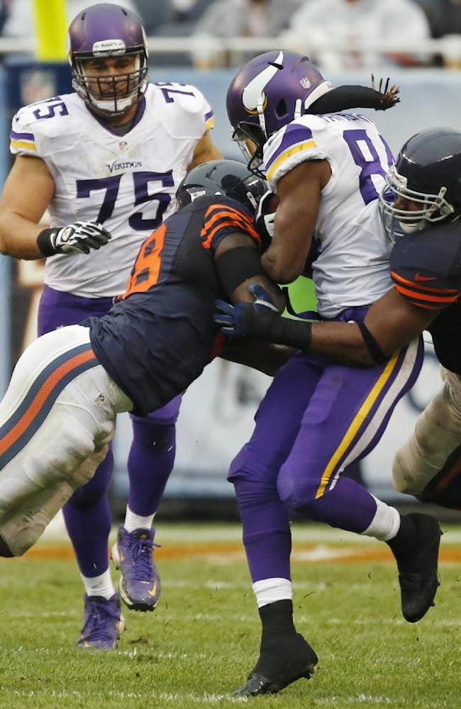 Minnesota Vikings wide receiver Cordarrelle Patterson (84) gets sandwiched between Chicago Bears linebackers D.J. Williams, left, and Lance Briggs during the second half of an NFL football game on Sunday, Sept. 15, 2013, in Chicago