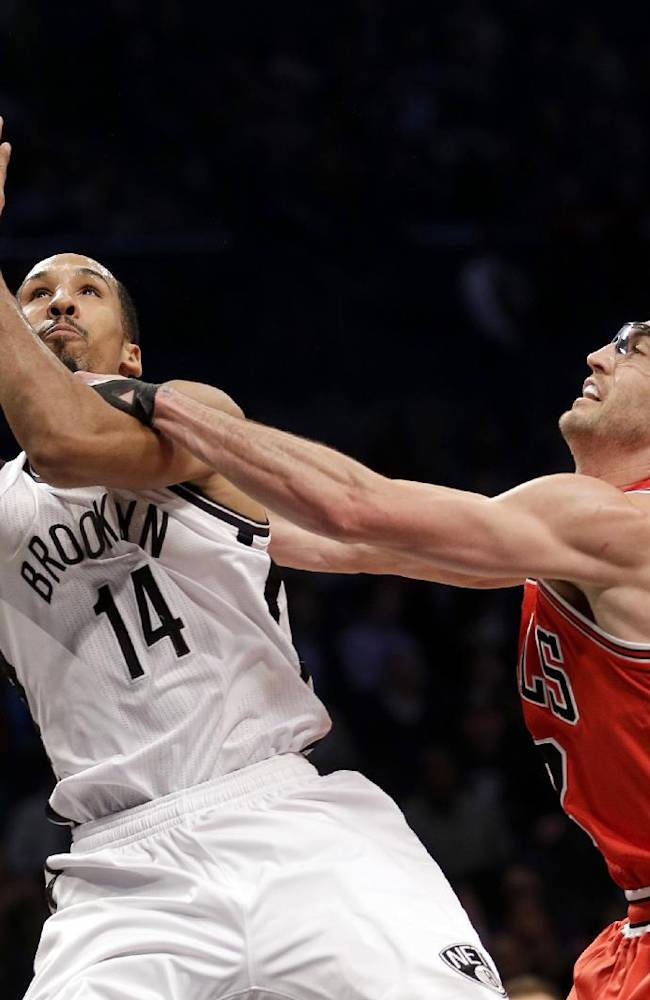 Chicago Bulls' Kirk Hinrich, right, fouls Brooklyn Nets' Shaun Livingston as he drives to the basket during the first half of an NBA basketball game Monday, March 3, 2014, in New York