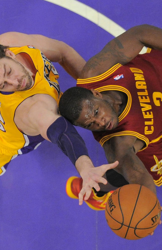 Cleveland Cavaliers guard Dion Waiters, right, puts up a shot as Los Angeles Lakers center Pau Gasol, of Spain, defends during the second half of an NBA basketball game, Tuesday, Jan. 14, 2014, in Los Angeles