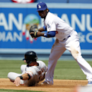 San Francisco Giants' Brandon Hicks, left, is forced out at second base as Los Angeles Dodgers shortstop Hanley Ramirez holds onto the ball in the second inning of a baseball game on Saturday, April 5, 2014, in Los Angeles The Associated Press