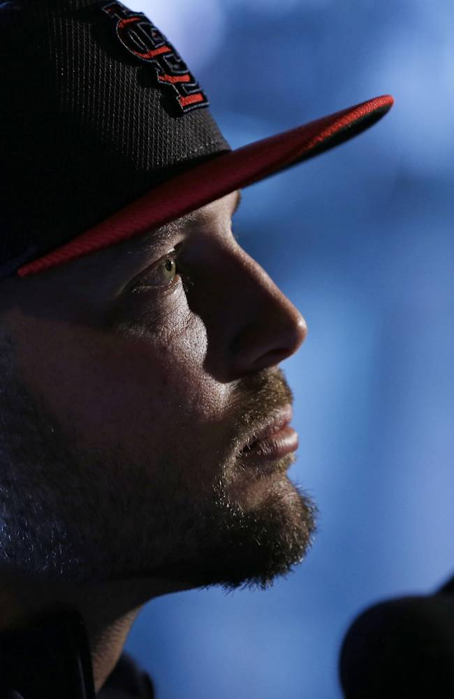 St. Louis Cardinals' Matt Holliday answers questions during a media availability for Game 1 of baseball's World Series against the Boston Red Sox Tuesday, Oct. 22, 2013, in Boston
