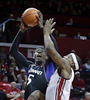 Cincinnati forward Justin Jackson (5) takes a shot past Rutgers forward Wally Judge (33) during the first half of an NCAA college basketball game Saturday, March 8, 2014, in Piscataway, N.J. (AP Photo/Mel Evans)