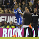 Didier Drogba takes to the pitch as he returns as a Chelsea player during his team's English Premier League soccer match against Burnley at Turf Moor Stadium, Burnley, England, Monday Aug. 18, 2014
