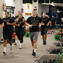 Arizona State football players run between workout stations at the football weight training room on Monday, July 21, 2014, in Tempe, Ariz The Associated Press