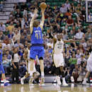Dallas Mavericks' Dirk Nowitzki (41) shoots a 3-pointer as Utah Jazz's Jeremy Evans (40) defends in the fourth quarter of an NBA basketball game Tuesday, April 8, 2014, in Salt Lake City. The Mavericks won 95-83. (AP Photo/Rick Bowmer)