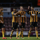 Hull City's, from left, Jake Livermore, Ahmed Elmohamady, David Meyler and Curtis Davies walk off the pitch together after being defeated 2-1 at the end of the English Premier League soccer match between West Ham and Hull City at Upton Park stadium in Lon