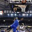 Dallas Mavericks guard Vince Carter, left, goes to the basket against Sacramento Kings center DeMarcus Cousins, right, during the first quarter of an NBA basketball game, Sunday, April 6, 2014, in Sacramento, Calif The Associated Press