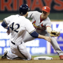 St. Louis Cardinals second baseman Mark Ellis tags out Milwaukee Brewers' Jonathan Lucroy as he is caught stealing during the second inning of MLB National League baseball game Tuesday, April 15, 2014, in Milwaukee The Associated Press