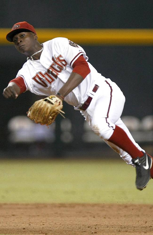 In this Aug. 13, 2013, file photo, Arizona Diamondbacks shortstop Didi Gregorius makes an off-balance throw during a baseball game against the Baltimore Orioles in Phoenix. A superb fielder, Gregorius faded at the plate late in the season and finished at .252 with 28 RBIs. Now he faces stiff competition from Chris Owings, considered the top position player in the Diamondbacks' minor league system