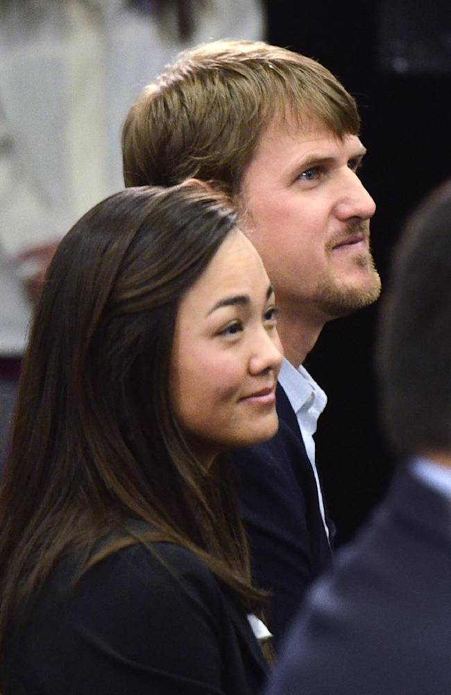 Dana Gross, accompanied her husband Jordan Gross, attend  news conference where he announced his retirement after 11 seasons as a pro football player in Charlotte, N.C., Wednesday, Feb. 26, 2014