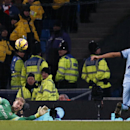 Manchester City's goalkeeper Joe Hart, reacts after saving a shot from Arsenal's Alexis Sanchez, as his defender Manchester City's Gael Clichy, No 22, and Arsenal's Hector Bellerin go for the lose ball during the English Premier League soccer match betw