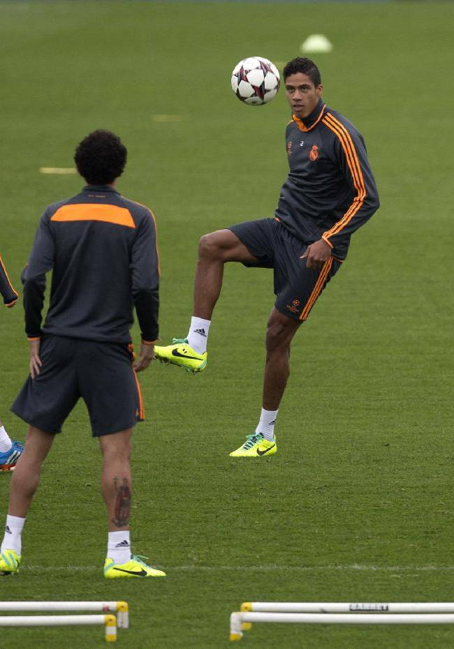 Real's Raphael Varane, centre, kicks the ball during a training session in Madrid, Spain, Tuesday Oct. 22, 2013. Real Madrid will play Juventus Wednesday in a Group B the Champions League soccer match