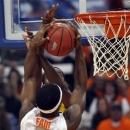 Syracuse's C. J. Fair is fouled by Alcorn State's Stephane Raquil during the first half of an NCAA college basketball game in Syracuse, N.Y., Saturday, Dec. 29, 2012. (AP Photo/Kevin Rivoli)