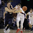 BYU's Kyle Collinsworth, left, and Gonzaga's Kyle Wiltjer go after a loose ball during the first half of an NCAA college basketball game, Saturday, Feb. 28, 2015, in Spokane, Wash. (AP Photo/Young Kwak)