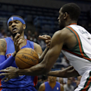 Milwaukee Bucks' Ekpe Udoh (5) knocks the ball away from Detroit Pistons' Josh Smith during the first half of an NBA basketball game on Wednesday, Dec. 4, 2013, in Milwaukee The Associated Press