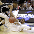 Providence's Bryce Cotton, left, battles North Carolina's Desmond Hubert, right, for a loose ball during the first half of a second-round game in the NCAA college basketball tournament Friday, March 21, 2014, in San Antonio The Associated Press
