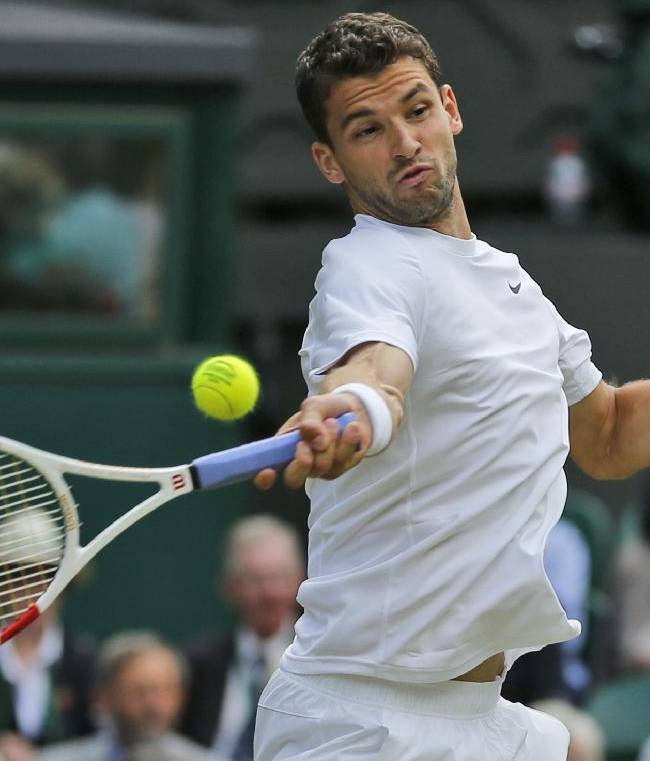 Grigor Dimitrov of Bulgaria returns to Luke Saville of Australia during their men's singles match at the All England Lawn Tennis Championships in Wimbledon, London, Wednesday, June 25, 2014