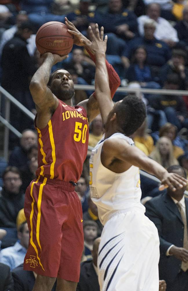Iowa State's DeAndre Kane, left, looks to shoot over West Virginia's Terry Henderson during the first half of an NCAA college basketball game, Monday, Feb. 10, 2014, in Morgantown, W.Va