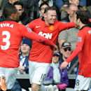 Manchester United's Wayne Rooney celebrates with Juan mata, right, and Patrice Evra after scoring against West Brom during the English Premier League soccer match between West Bromwich Albion and Manchester United at The Hawthorns Stadium in West Bromwich