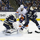 Columbus goalie Sergei Bobrovsky (72), of Russia, blocks a shot by New York Islanders' Pierre-Marc Bouchard (96) as teammate Fedor Tyutin (51) helps during the first period of an NHL hockey game Saturday, Nov. 9, 2013, in Columbus, Ohio The Associated Pre