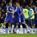 Chelsea's Branislav Ivanovic, left, is congratulated by teammates after scoring during the English League Cup semifinal second leg soccer match between Chelsea and Liverpool at Stamford Bridge stadium in London, Tuesday, Jan. 27, 2015