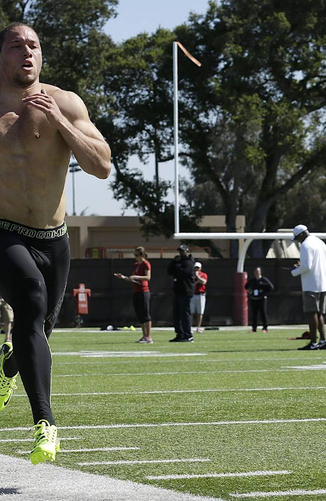 Stanford safety Ed Reynolds runs during pro day for NFL football representatives in Stanford, Calif., Thursday, March 20, 2014