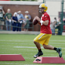 Green Bay Packers' Aaron Rodgers runs a drill during NFL football training camp on Saturday, July 26, 2014, in Green Bay, Wis The Associated Press