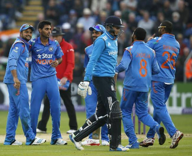 India's Bhuvneshwar Kumar, second left celebrates taking the wicket of England's Joe Root clean bowled during their One Day International cricket match at the SWALEC cricket ground in Cardiff, Wales, Wednesday, Aug. 27, 2014