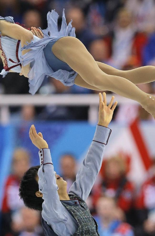 Narumi Takahashi and Ryuichi Kihara of Japan compete in the team pairs free skate figure skating competition at the Iceberg Skating Palace during the 2014 Winter Olympics, Saturday, Feb. 8, 2014, in Sochi, Russia