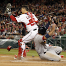 Washington Nationals catcher Jose Lobaton makes the force out on St. Louis Cardinals' Jon Jay at home during the fourth inning of a baseball game at Nationals Park on Thursday, April 17, 2014, in Washington The Associated Press