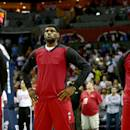 FILE - JUNE 28, 2014: It was reported that both Dwyane Wade and Chris Bosh are opting out of their contracts with the Miami Heat in order to be free agents June 28, 2014. CHARLOTTE, NC - APRIL 28: Chris Bosh #1 of the Miami Heat stands alongside teammates LeBron James #6 and Dwyane Wade #3 while wearing inside out warm up jerseys before playing the Charlotte Bobcats in Game Four of the Eastern Conference Quarterfinals during the 2014 NBA Playoffs at Time Warner Cable Arena on April 28, 2014 in Charlotte, North Carolina. (Photo by Streeter Lecka/Getty Images)