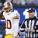 Washington Redskins quarterback Robert Griffin III (10) walks to the sidelines during the fourth quarter of an NFL football game against the New York Giants, Sunday, Dec. 14, 2014, in East Rutherford, N.J The Associated Press