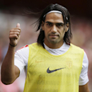 FILE - This is a Saturday, Aug. 2, 2014 file photo of AS Monaco player Radamel Falcao as he gives a thumbs up to fans as he warms up on the sideline during the second half of the Emirates Cup soccer match between AS Monaco and Valencia at Arsenal's Emirat