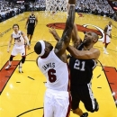 image made with a fish-eye lens, Miami Heat small forward LeBron James (6) blocks the shot of San Antonio Spurs power forward Tim Duncan (21) during the first half of Game 2 in the NBA Finals basketball game, Sunday, June 9, 2013 in Miami. The Miami Heat won 103-84. (AP Photo/Larry W. Smith, Pool)