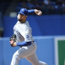 Kansas City Royals' James Shields pitches against the Toronto Blue Jays during the first inning of a baseball game on Sunday, Sept. 1, 2013 in Toronto. (AP Photo/The Canadian Press, Jon Blacker)